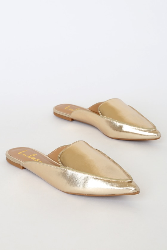 Lulus Exclusive! The Lulus Joelle Gold Loafer Slides are model-off-duty meets office chic! Elevate any outfit with these loafer slides, formed from vegan leather. Pointed-toe upper, stitched detail, and a notched collar create a classic look across the slip-on design that\'s perfect for on-the-go gals! Fit: This garment fits true to size. 0. 25\