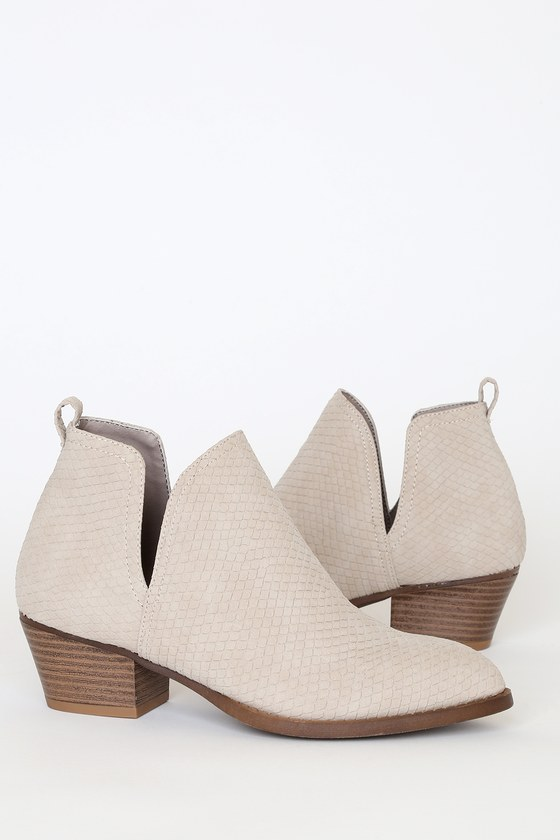 The CL by Laundry Caring Pale Taupe Snake Pointed-Toe Ankle Booties are a wardrobe essential! Sleek pale taupe snake-embossed vegan leather forms a pointed-toe upper and notched vamp, with pull tab at back for easy on and off, all atop a comfortable block heel. 2\