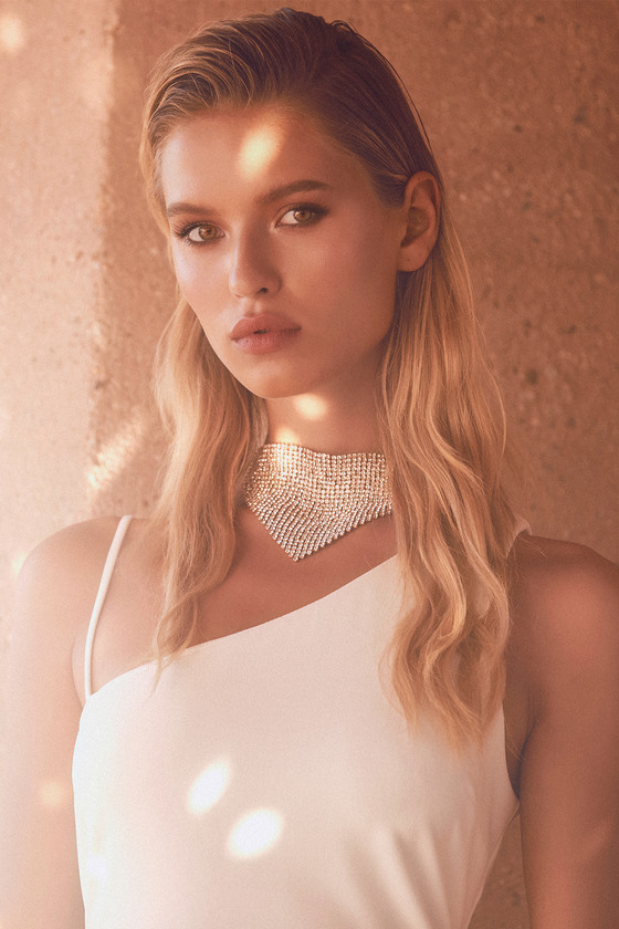 Accessorize to the nines with the Petit Moments Naomi Gold Rhinestone Choker Necklace! Sparkling clear rhinestones in a gold setting are linked together to create a chainmail-style choker that falls into a bandana-inspired shape. Lobster clasp closure. 11. 25\