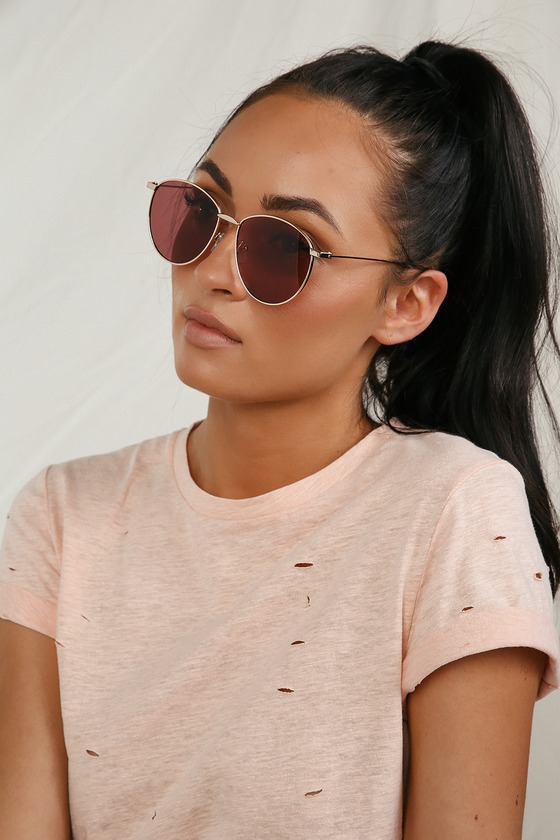 Cruise around looking cool as can be with the Lulus Slow Ride Gold and Pink Round Sunglasses! Slightly oversized round gold frames hold pink lenses for a perfectly rose-tinted perspective! Frames measure 5. 5\