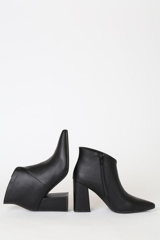 Feel like your best self in the Renna Black Pointed-Toe Ankle Booties! These trendy booties are formed by smooth, vegan leather that shapes a classic pointed-toe upper and ankle high shaft. A chic, asymmetrical seam leads up to an angled topline that give these booties a modern touch while a flared block heel makes these babies comfy for all day wear! 5\\\