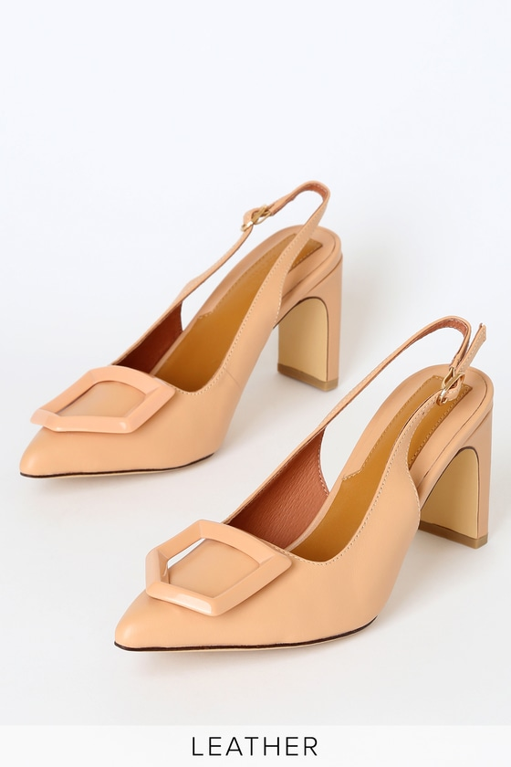 The Jagger The Label Amberlight Ornament Leather Slingback Heels are classy and timeless and always in style! Smooth genuine leather shapes a pointed-toe upper, accented with a glossy geometric charm. Matching adjustable slingback strap (with gold buckle) and sculpted heel finish the look! Available in Euro sizes only. 3\