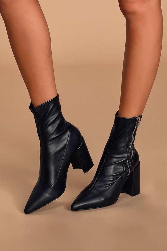 The Aleeyah Black Pointed-Toe Sock Boots are our new faves! Soft vegan leather shapes these cute boots, that boast a structured, pointed-toe upper and slouchy shaft that hugs the ankle perfectly, all atop a trendy angled block heel. Exposed silver zipper at side. 3. 5\
