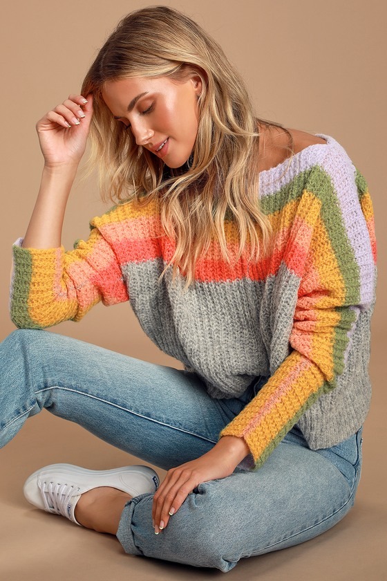 Set your sights high with the Free People See the Rainbow Grey Rainbow Striped Sweater! Super soft alpaca-blend knit, accented with bright rainbow stripes, shapes a boat neckline that can be worn on or off-the-shoulder, and long sleeves. Relaxed bodice provides that perfect, cozy fit. Pair with jeans and sneakers for a comfy and cute look! Fit: This garment fits true to size. Length: Size small measures 19.5\
