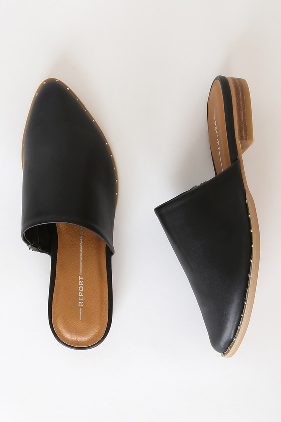 The Report Irina Black Pointed Toe Mules are your new everyday, wear-with-everything shoe! Sleek and soft faux leather shapes a pointed-toe upper with a gusset at the side for fit. Shiny silver studs decorate the outsole to give these mules an edgy flair! Slide-on design. 1\