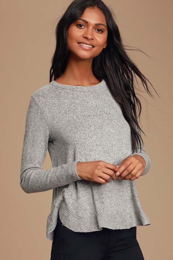 You\'ll instantly feel put together when you throw on the Easy Going Heather Grey Sweater Top! Super soft, lightweight stretch-knit shapes this cozy top featuring a crew neckline, long sleeves, and a flowy bodice. Ribbed knit accents the arms and the ruffled, rounded hem. Fit: This garment fits true to size. Length: Size small measures 24\