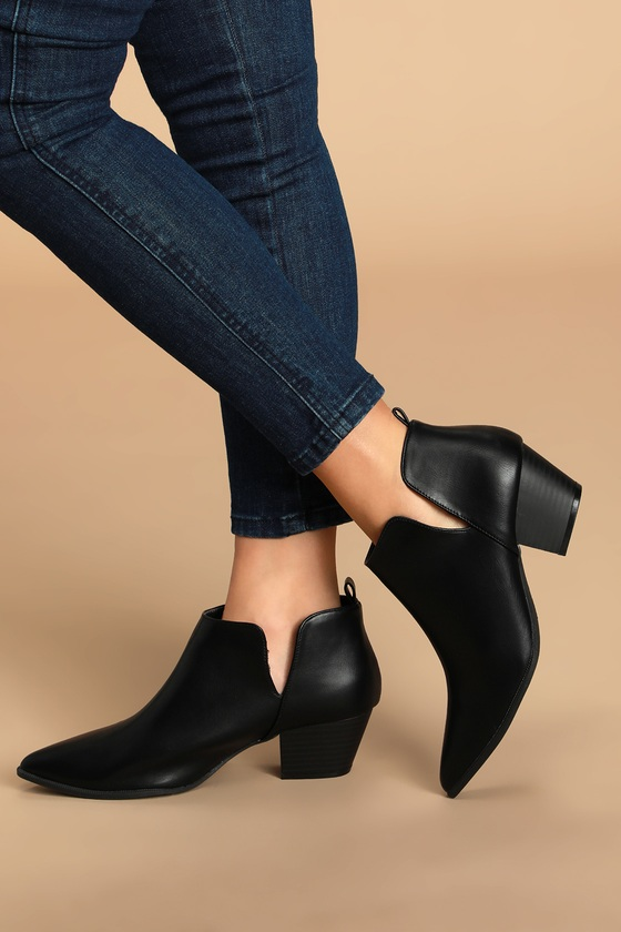 We can\\\'t help but adore the Lulus Marca Black Ankle Booties! Sleek vegan leather creates a stylish pointed-toe upper and an ankle-high shaft, with cutouts at the instep and outstep. Pull-tab at back for easy on/off. These little cuties are perfect for pairing with a midi dress or with your favorite jeans when the weather starts getting cooler! Fit: This garment runs large - please size down. 2\\\