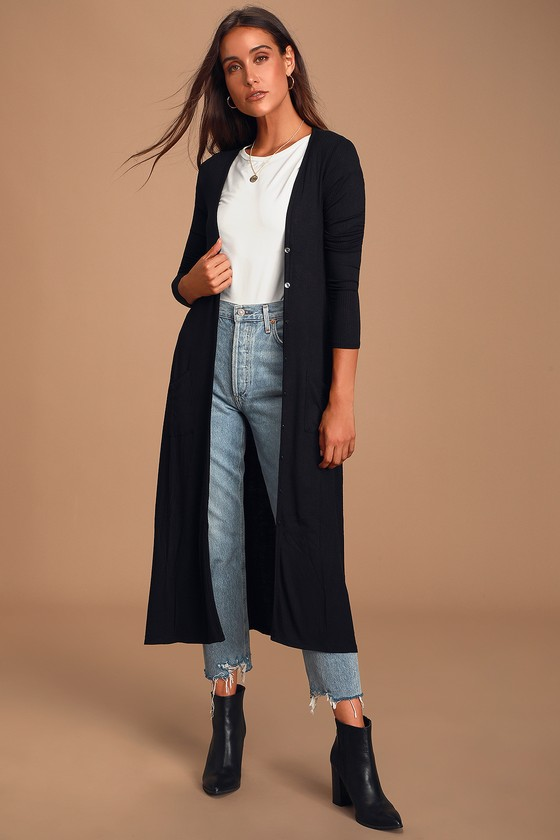 Every movement you make in the Lulus Basics Graceful Ways Black Long Cardigan Sweater will be filled with beauty! Ribbed knit shapes this lightweight cardigan with a long, button-up bodice and front patch pockets. Long sleeves. Fit: This garment fits true to size. Length: Mid-calf length. Size small measures 47.5\