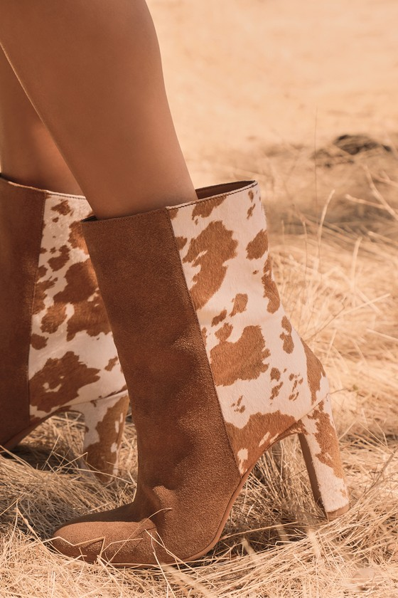 Lulus Exclusive! Step into a sophisticated look with the Dolce Vita X Lulus Chase Brown Multi Suede Leather Mid-Calf Boots! Genuine suede and dyed cow hair, in white and brown hues, work together to create a chic two-tone look across these ultra-trendy boots with an almond toe upper, thin block heel, and mid-calf shaft. Pull-on design. 3. 5\