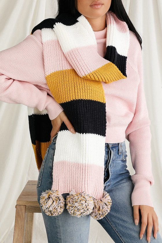 Keep cozy and cute this chilly season with the Lulus Jolinda Pink Multi Colorblock Scarf! Adorably oversized scarf has a cozy knit construction and features a mustard yellow, navy blue, pink, and white colorblock pattern, finished with matching pom pom accents. 90\