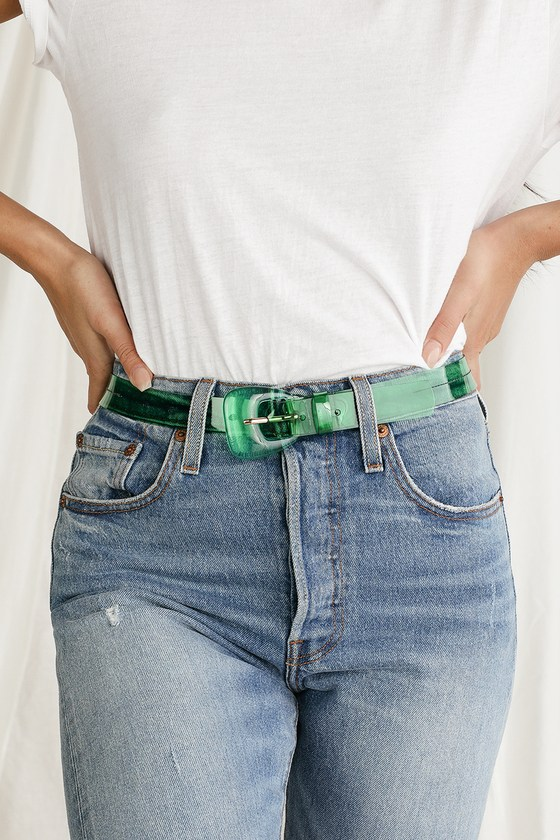 Make a statement with the Petit Moments All Mod Emerald Green Lucite Belt! Transparent green PVC shapes this uniquely chic belt that features a chunky lucite buckle with shiny gold prong. Add this belt to your next look give it a fun pop of color! Small measures 37\
