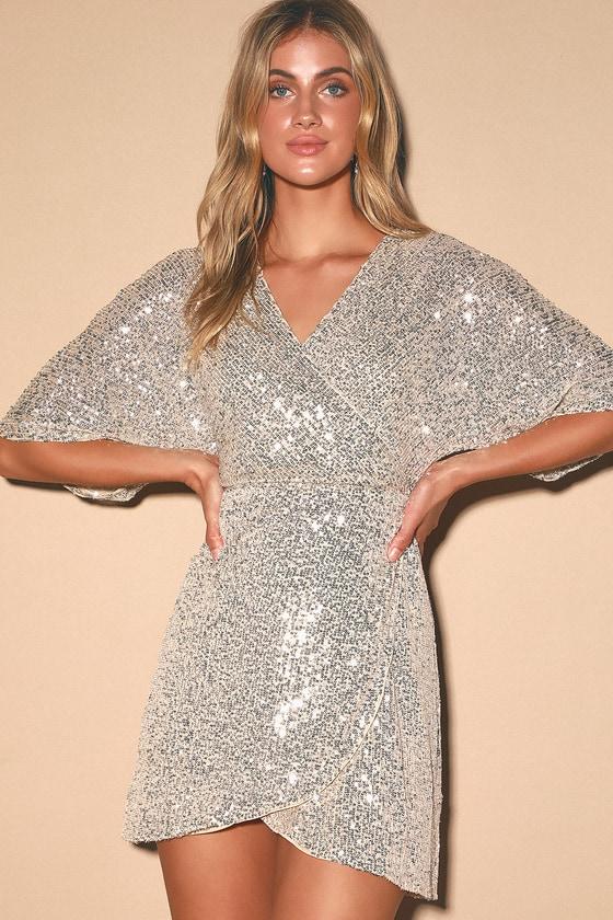 70s Dresses – Disco Dress, Hippie Dress, Wrap Dress Weekender Silver Sequin Faux-Wrap Mini Dress - Lulus $84.00 AT vintagedancer.com