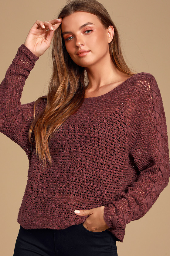 Channel some chill vibes in the Billabong Chill Out Burgundy Loose Knit Sweater! Soft and airy loose gauge knit shapes this trendy sweater with a wide scoop neckline, long sleeves, and a wide-cut, boxy bodice. Trendy lace-up detail adds a little something extra along the sleeves! Throw this sweater over your favorite flirty bralette for a laid-back but super cute look! Undershirt not included. Fit: This garment fits true to size. Length: Size small measures 18\