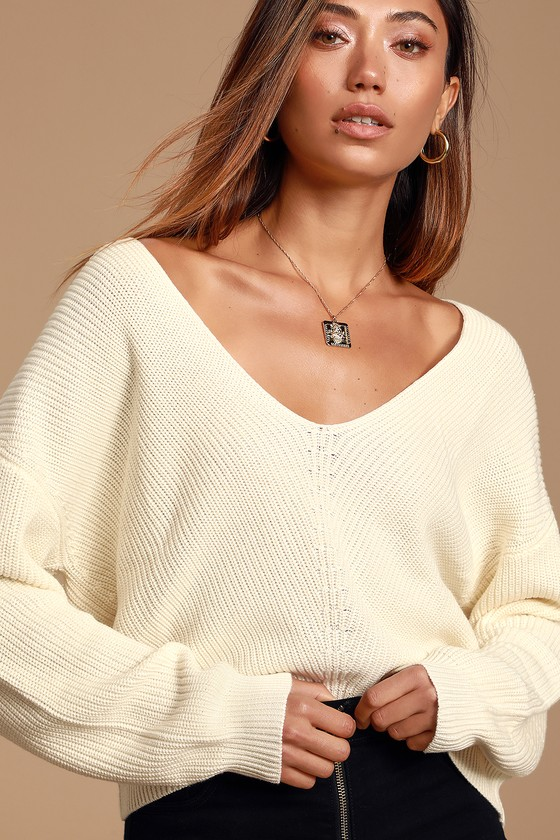Lulus Exclusive! Basic and cozy, the Lulus Feel it Still Ivory Knit Sweater is a closet essential! Soft and slightly stretchy knit shapes this sweater with a deep V-neckline, long sleeves with drop shoulders, and a relaxed boxy bodice. Contrasting knit detail at the center seam adds a unique vibe. Ribbed knit accents the cuffs and hem. Fit: This garment fits true to size. Length: Size small measures 21\
