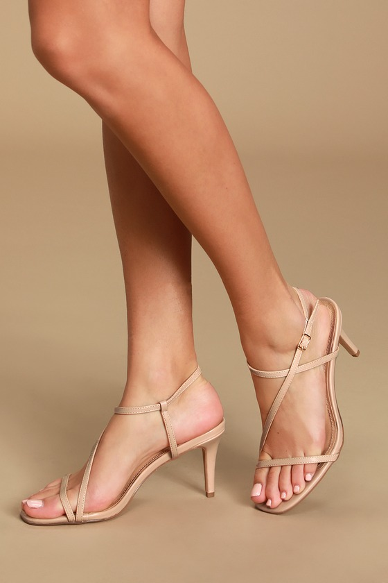 Lulus Exclusive! Put your best foot forward in the Lulus Dannay Nude High Heel Sandals! Smooth vegan leather shapes these cute little heels that feature a slightly squared, peep-toe upper, with a slender toe strap. Matching asymmetrical vamp strap wraps around and secures at the ankle with a dainty gold buckle. Mid-height stiletto heel adds style without sacrificing stability! 3\