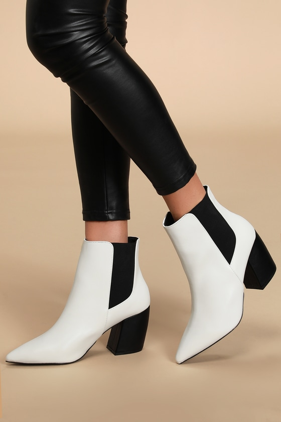 Step out looking proper and polished with the help of the Cecy White Pointed Toe Ankle Booties! These sleek booties have a smooth vegan leather upper with a pointed toe, plus black elastic gussets along the ankle-high shaft and contrasting black block heel. Fit: This garment fits true to size. 3\\\