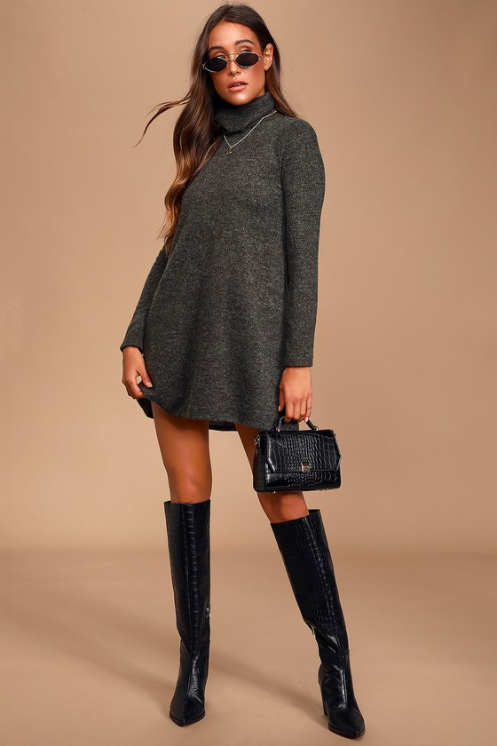 Lulus Exclusive! Pair the Lulus Alaina Dark Olive Green Long Sleeve Turtleneck Sweater Dress with some over-the-knee boots for a chic, cozy look! Soft and slightly fuzzy knit composes this lightweight and cozy little dress. Relaxed bodice with a turtleneck and long, fitted sleeves. The skirt flares slightly as it falls to a flirty hemline. Fit: This garment fits true to size. Length: Mid-thigh. Size small measures 32.5\