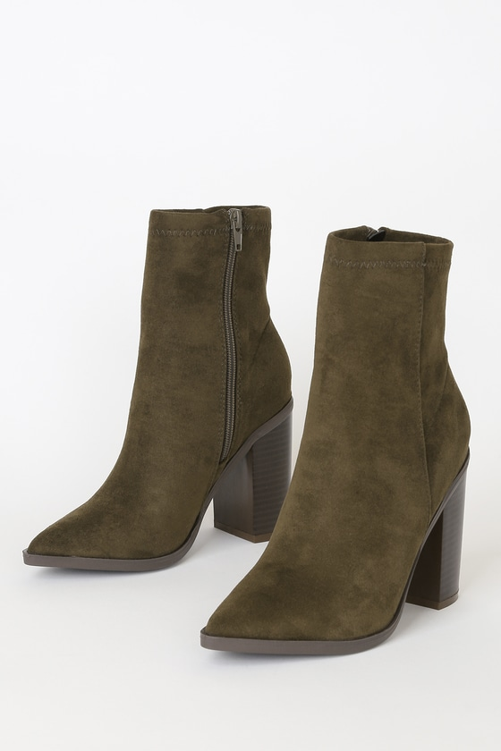 The Essex Olive Suede Mid-Calf Booties are so cute, you\'ll want to pair them with every outfit! Soft, vegan suede shapes a pointed-toe upper, and rises into a fitted, 8\