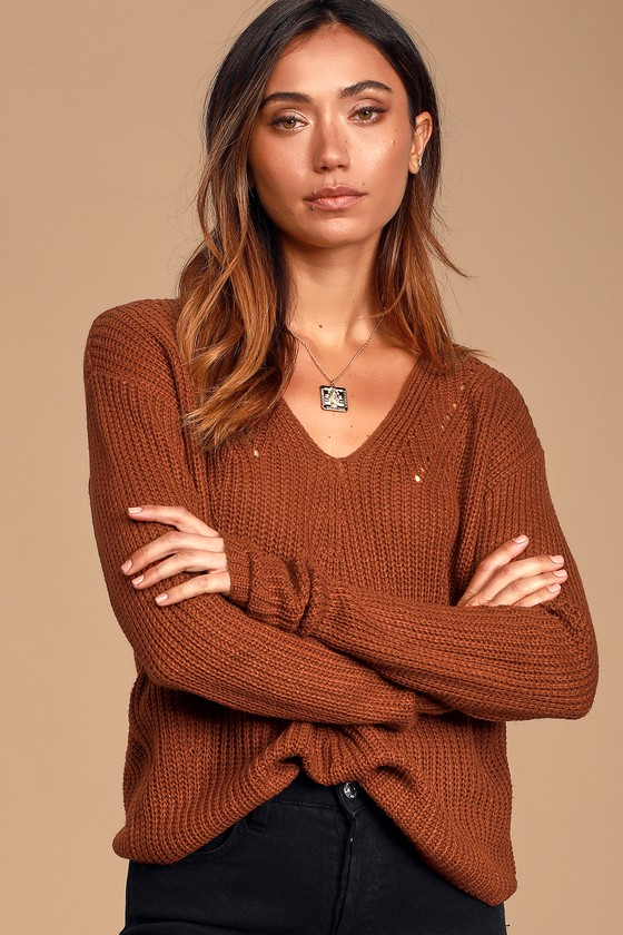 Get ready for the cool days ahead in the Lulus Halifax Rust Red Knit Sweater! Soft, loose knit shapes this adorable sweater that features a pullover design, drop shoulders, long sleeves, and a V-neckline, trimmed with pierced detail. Relaxed-fit silhouette and slightly cropped hem make this sweater perfect to tuck into your favorite high-waisted bottoms! Fit: This garment fits true to size. Length: Size small measures 20\