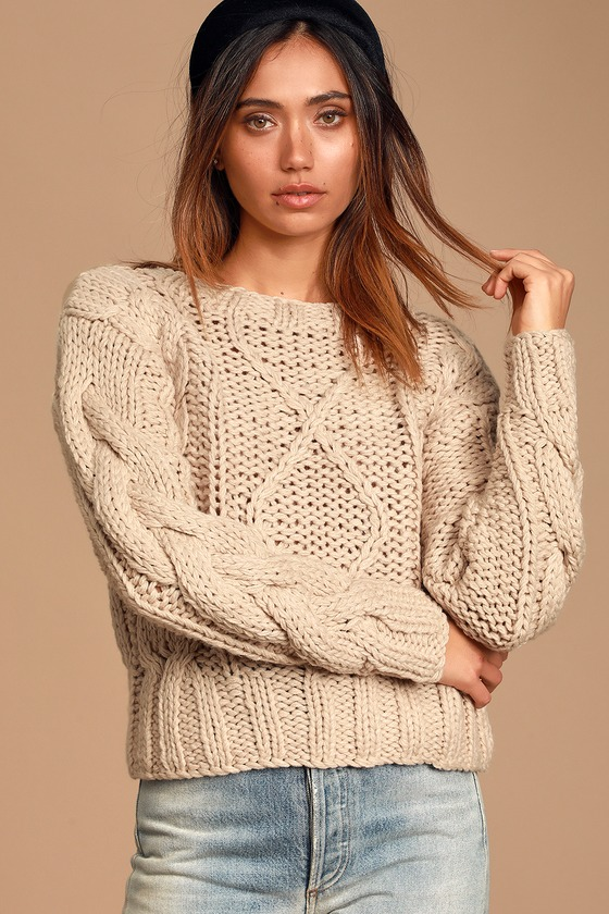 Snuggling up in the Lulus Jaylene Beige Cable Knit Sweater is the best! Chunky cable knit is ultra-plush as it shapes this cozy sweater with a round neckline, long sleeves with drop shoulders, and a slightly oversized bodice. Ribbed knit trims the neckline, cuffs, and hem. Pair with a cup of cocoa on a chilly day! Fit: This garment fits true to size. Length: Size small measures 21.5\