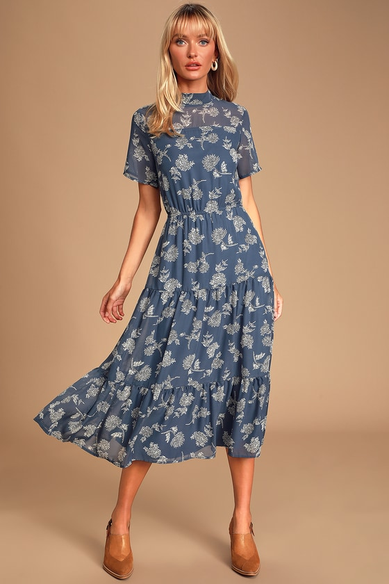Lulus Exclusive! Get a lovely look for an evening out with the Lulus Floral Dressed Up Dusty Blue Floral Print Midi Dress! Elegant cream and black floral print embellishes dusty blue lightweight woven fabric as it forms a mock neck (with back button closure), sheer decolletage and short sleeves, and a darted bodice. Elastic waist tops a tiered skirt that flows to a modest midi length. Pair with strappy heels and a clutch for the perfect date night \'fit! Fit: This garment fits true to size. Length: Mid-calf length. Size small measures 46.5\