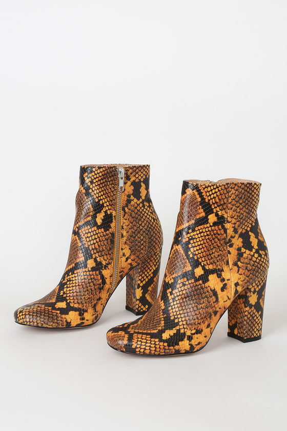 Keep your look chic and polished from head to toe with the Steve Madden Pixie Yellow Snake Mid-Calf Booties! Bold yellow snake-embossed vegan leather creates these cute boots with a rounded toe, a sleek mid-calf height shaft, and a 6.5\