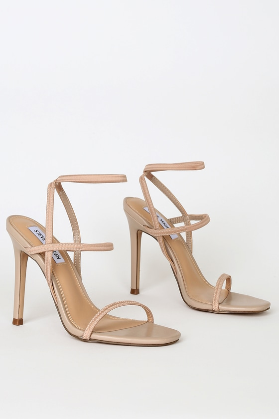 Slip on the Steve Madden Nectur Nude High Heel Sandals for an instant confidence boost! A slender toe band tops a strappy vamp and matching ankle strap, all shaped by comfortable elastic straps! Pair with an LBD and sunnies for a classic, sexy look! 4. 25\