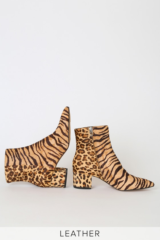 Lulus Exclusive! The Dolce Vita X Lulus Bel Tiger Multi Calf Hair Ankle Booties are the talk of the town! Soft genuine calf hair, in a fierce tiger print, shapes a sleek pointed-toe upper, and ankle high shaft, with a contrasting leopard print ankle and heel for a little added flair! 2. 75\
