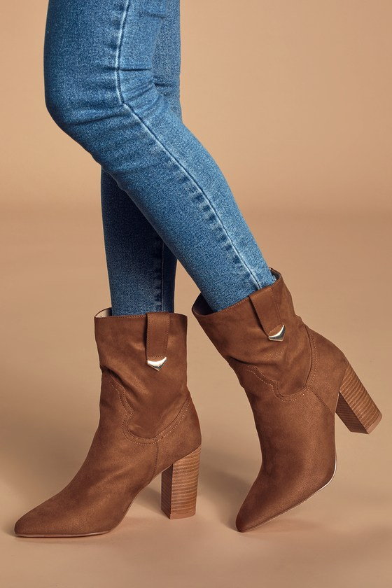 Lulus Exclusive! Step into fall in style in the Lulus Taryne Taupe Suede Pointed-Toe Booties! These cute little boots are composed of soft vegan suede and feature a pointed-toe upper and slouchy, mid-calf shaft that is giving us major Western-chic vibes, thanks to pull tabs with shiny gold accents at the instep and outstep. 3. 5\