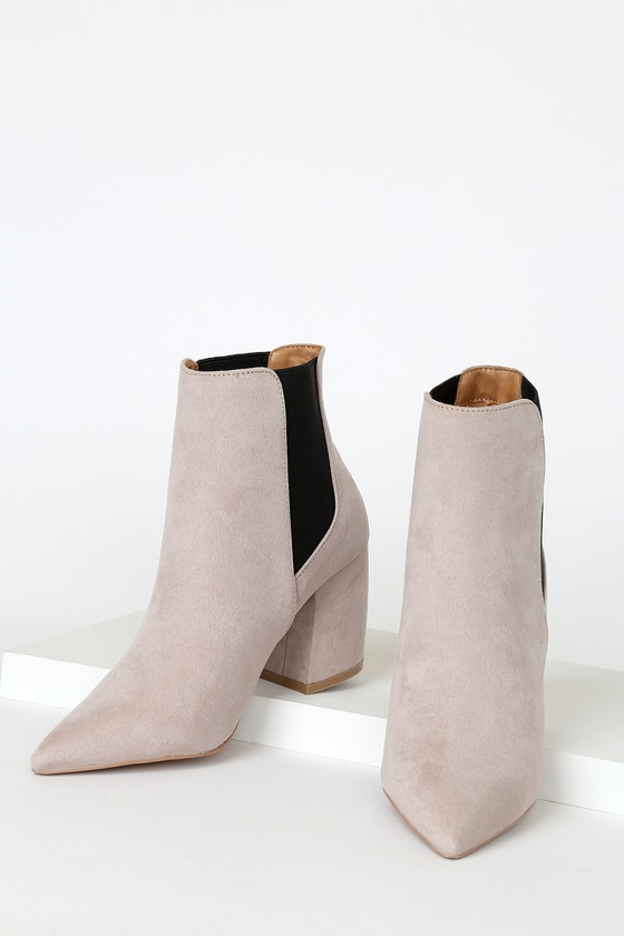 Step out looking proper and polished with the help of the Lulus Cecy Taupe Suede Pointed Toe Ankle Booties! These sleek booties have a soft vegan suede upper with a pointed toe, plus black elastic gussets along the ankle-high shaft. Fit: This garment fits true to size. 3\