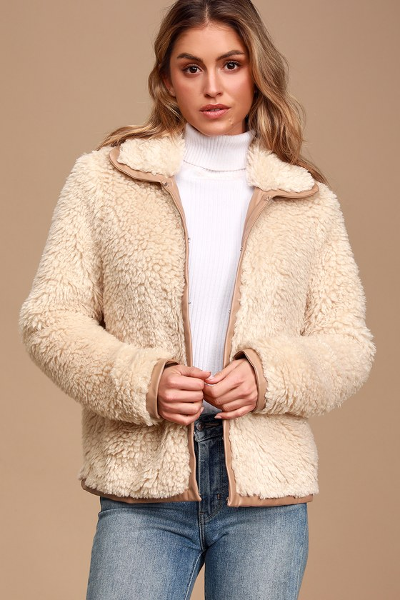Lulus Exclusive! Keep warm and cozy on the coldest of days in the Lulus Fur-Evermore Cream Faux-Fur Jacket! Soft faux sherpa shapes this adorable jacket with a collared neckline, long sleeves, and a boxy silhouette with hidden clasp closure down the front and twin welt pockets. Tan vegan leather trim lines the collar, cuffs, bodice, and hem. Fit: This garment fits true to size. Length: Size small measures 25.5\