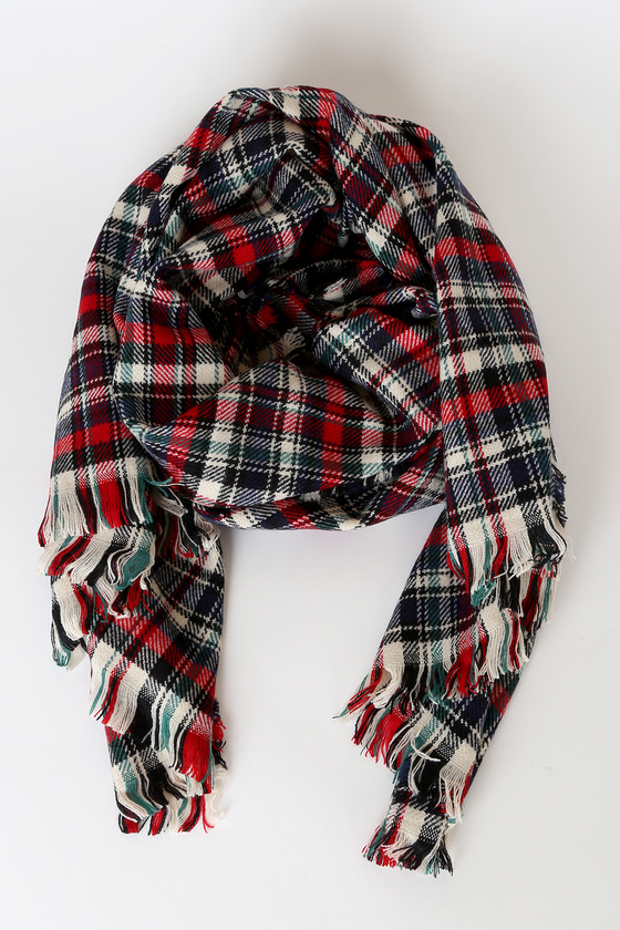 Accessorize perfectly with the Lulus Uniform Multi Plaid Oversized Scarf! Cozy knit, in a cream, navy blue, red, and green plaid pattern, forms this cute scarf that features an oversized design and matching fringe trim at the ends. 80\