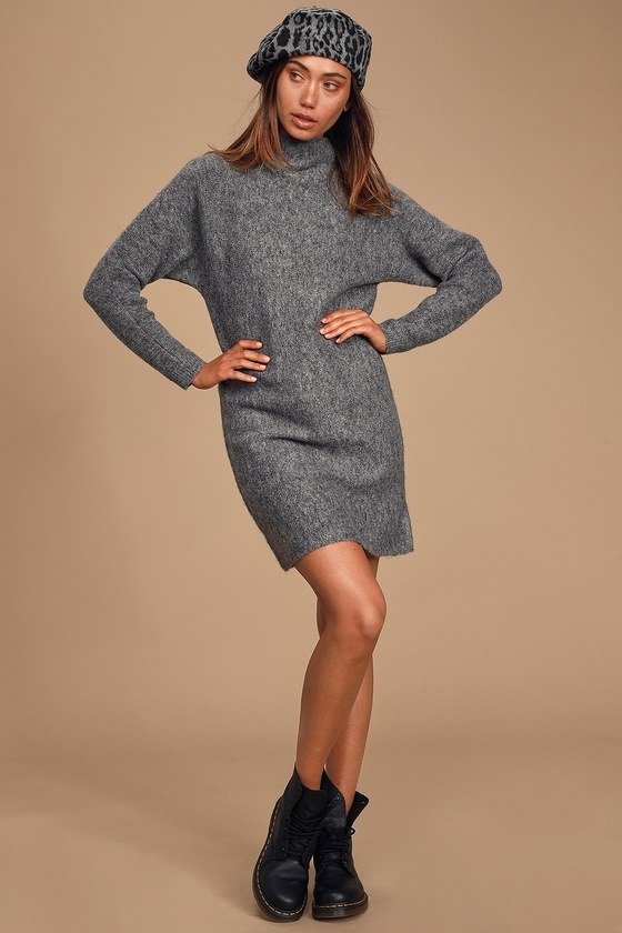 The RD Style Change Your Tune Grey Mock Neck Sweater Dress will keep you cozy and cute no matter what the weather has in store! Medium-weight, stretch knit shapes this cute sweater dress that features a mock neckline, long fitted sleeves, and relaxed bodice with a mini hem. Pair with over-the-knee boots for an adorable fall look! Fit: This garment fits true to size. Length: Above mid-thigh. Size small measures 32.5\