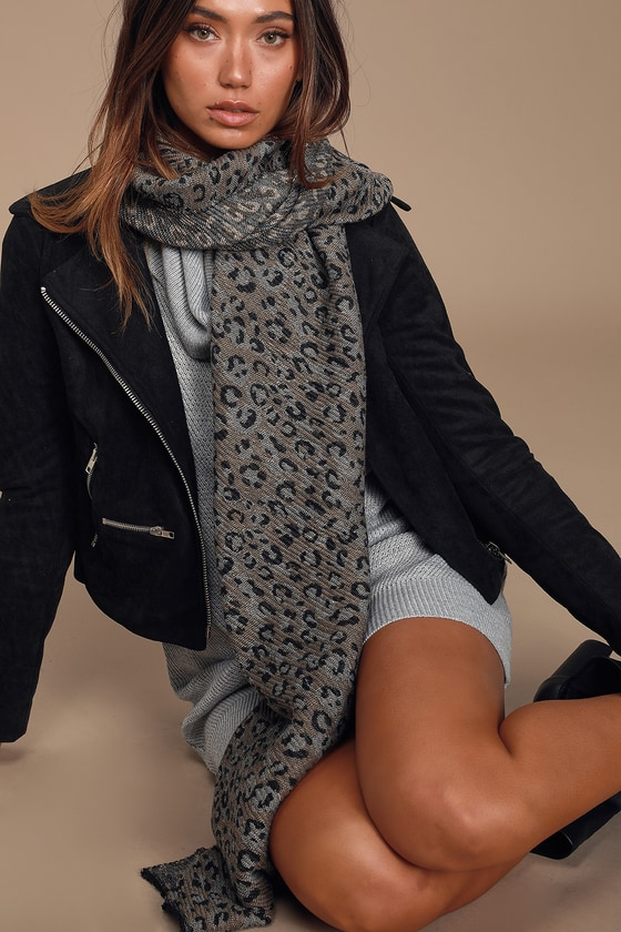 Stay warm while still looking fabulous with the Lulus Getting Chilly Grey Leopard Print Scarf! Soft and stretchy knit, with a black, tan, and grey leopard print pattern, shapes this chic sweater, complete with a fun fringe detail. Pair this scarf with a sweater dress and knee-high boots for a fashion-forward look! 78\
