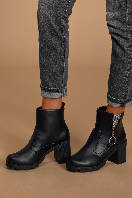 The Amiel Black Platform Ankle Boots are here to elevate your shoe game! Sleek vegan leather shapes these cold-weather essential boots that have a lug sole platform footbed, rounded toe upper, and an ankle-high shaft with seam detail at the vamp. 5\