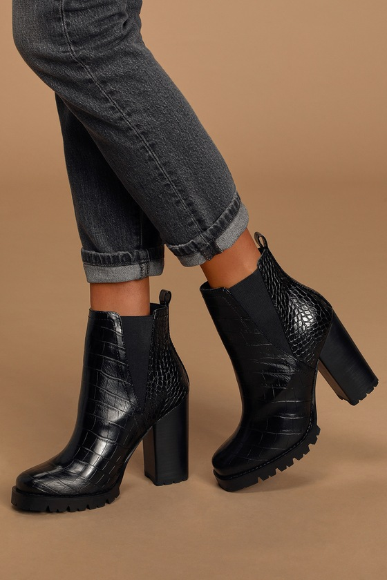 Step into this season\'s hottest trends with the Steve Madden Ladon Black Crocodile Platform Ankle Boots! Sleek, crocodile-embossed faux leather shapes these edgy boots that have a platform footbed, square toe upper, and an ankle-high shaft. Pull tab at the back and elastic gussets at the instep and outstep make for easy on and off. The chunky block heel gives you some lift with plenty of support! Fit: This garment runs small - please size up. 4\