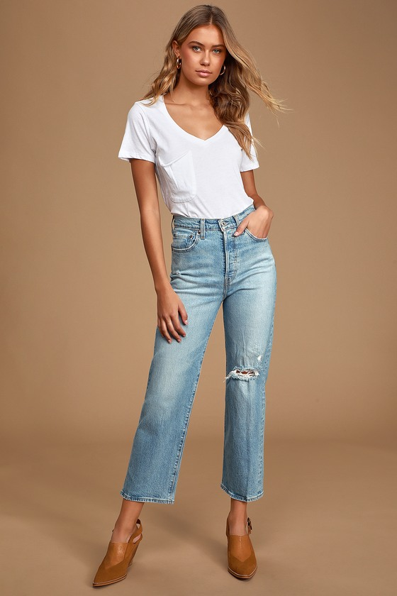 Don\'t be surprised if the Levi\'s Ribcage Light Wash Distressed Straight Ankle Jeans become your new go-to denim! Sturdy denim (in Levi\'s Tango Fade wash) shapes these essential jeans that feature a high-waisted fit, belt loops, and five-pocket cut. Relaxed-fit, straight pant legs boast light fading and trendy rips and end in ankle-length, cropped hems. Branded top button and hidden button-fly. Red logo tag and leather patch at back. Fit: This garment fits true to size. Length: Ankle length. Size 26 measures 37.5\