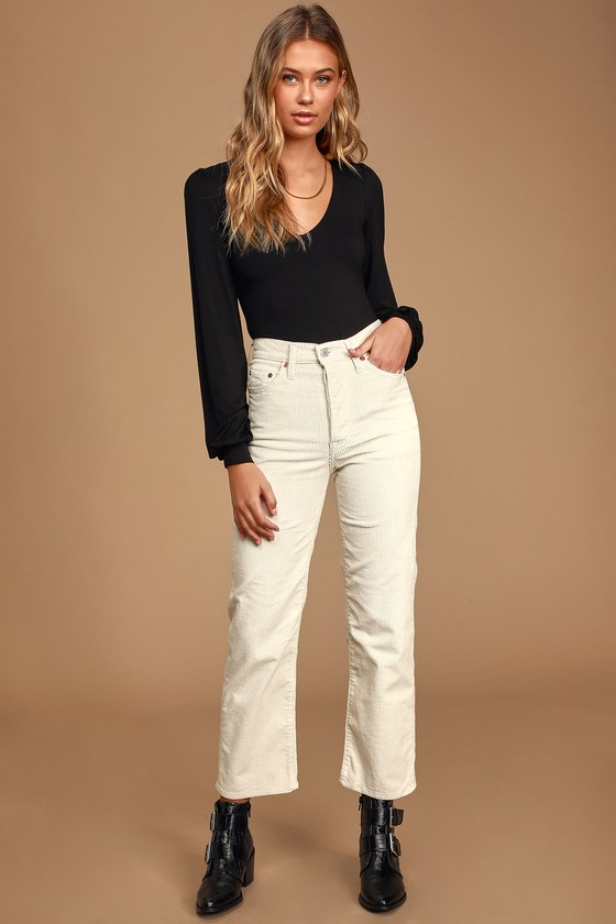 We can\'t wait to get our hands on the Levi\'s Ribcage Beige Corduroy Straight Ankle Jeans! These adorable pants are composed of soft corduroy and feature a high-waisted fit, belt loops, and five-pocket cut. Relaxed-fit, straight pant legs end in ankle-length cropped hems. Branded top button and hidden button-fly. White logo tag and leather patch at back. Fit: This garment fits true to size. Length: Ankle length. Size 26 measures 38.5\