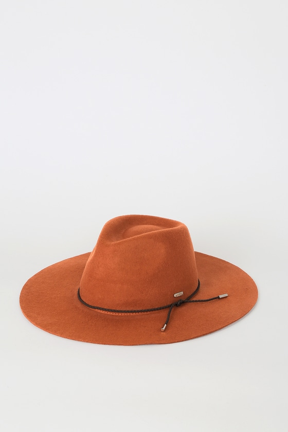 Take your look from cute to complete with the San Diego Hat Co. Totally Into It Rust Wool Fedora Hat! Soft wool shapes this wide-brimmed fedora hat with a braided, brown vegan leather band embellishment and silver hardware. One size fits most. 3. 75\