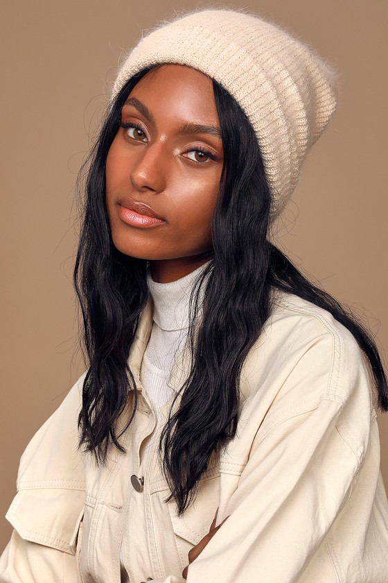 Keep as cozy as can be in the Lulus Happy To Be Here Cream and Gold Ribbed Beanie! This cute beanie is composed of cozy, cream ribbed knit with delicate eyelash detailing and shimmering gold threading throughout. Pair with your favorite sweater and high-waisted jeans for a laid back look! 11\