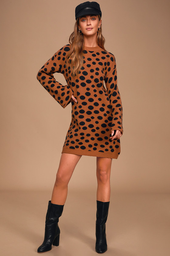 Fall fashion has never looked as good as the Lulus Aspire to Inspire Rust Brown Polka Dot Sweater Dress! Cozy stretch knit, covered in cute little black polka dots, shapes this chic sweater dress that has a rounded neckline and trendy long bell sleeves. A relaxed bodice leads into a slightly slouchy mini skirt. Solid ribbed knit accents the neck and hem. Fit: This garment fits true to size. Length: Above mid-thigh. Size small measures 31.5\