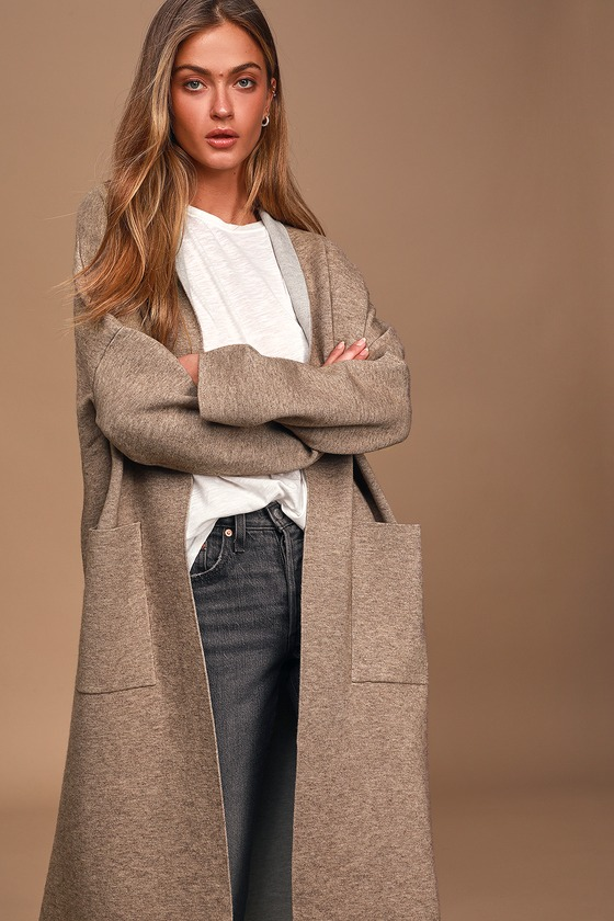 The Lulus Staying Warm Taupe Coatigan will add a sophisticated touch to your next look without compromising comfort! Soft, medium-weight knit, with a contrasting grey lining, shapes this timeless coat-meets-cardigan with a collared neckline, long sleeves with drop shoulders, and an open front design with two large patch pockets. Fit: This garment fits true to size. Length: Size small measures 45.5\