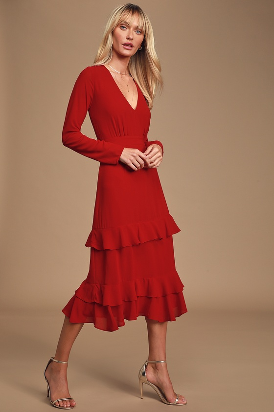 Lulus Exclusive! Dance under the moonlight in the Lulus Sway This Way Red Ruffled Long Sleeve Midi Dress! This stunning dress is composed of gauzy woven fabric and features a plunging V-neckline and relaxed bodice, framed by fitted long sleeves. Banded waist tops a full midi skirt with a flirty, tiered double-ruffle hem. Hidden back zipper/clasp. Fit: This garment fits true to size. Length: Mid-calf length. Size small measures 45\