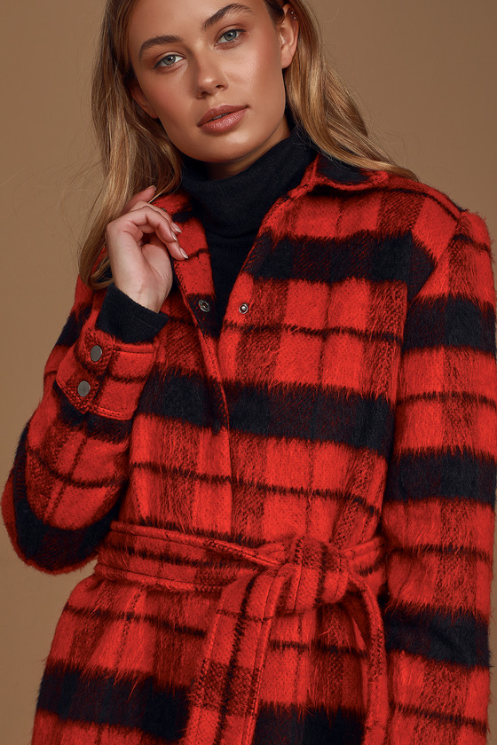 Today just got a whole lot cuter thanks to the BB Dakota Wild and Wooly Red Plaid Coat! Fuzzy wool-blend fabric, covered in the cutest red and black plaid pattern, shapes this essential coat with a collared neckline and long sleeves with snap button cuffs. Flannel shirt-inspired silhouette has a snap button placket and a rounded hem. Removable tying sash belt and hidden side seam pockets make the finishing touches! Fit: This garment fits true to size. Length: Size small measures 33.5\