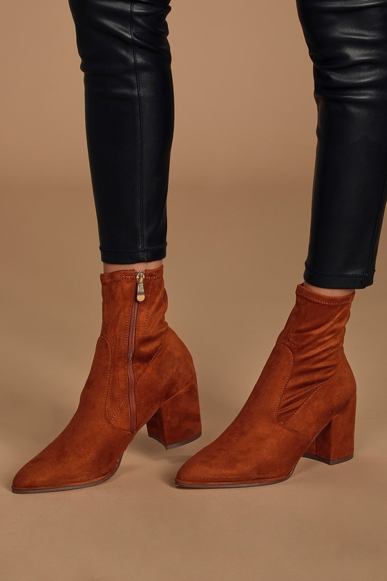 Show up looking chicer than ever in the Lulus Viviyana Rust Suede Ankle Sock Boots! Soft vegan suede creates these chic booties with a pointed-toe upper and stretchy mid-calf shaft, that creates a trendy sock boot silhouette. Seam detail at the vamp adds some flair while a 9\