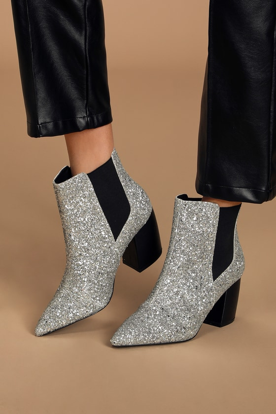 Step out looking proper and polished with the help of the Lulus Cecy Chunky Silver Glitter Pointed Toe Ankle Booties! These sleek booties have a sparkly silver glitter upper with a pointed toe, plus black elastic gussets along the ankle-high shaft and contrasting black block heel. 3\