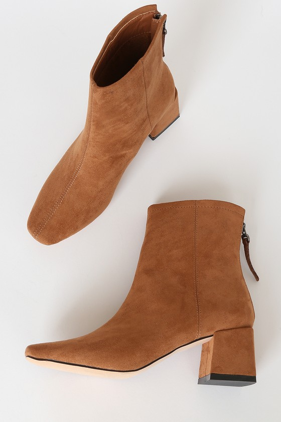 Lulus Exclusive! Step up your shoe game with the Lulus Keaton Brown Suede Ankle Booties! These cold-weather essential boots are made from soft vegan suede and feature an squared-toe upper and ankle-grazing shaft, all atop a trendy flared block heel. 5\