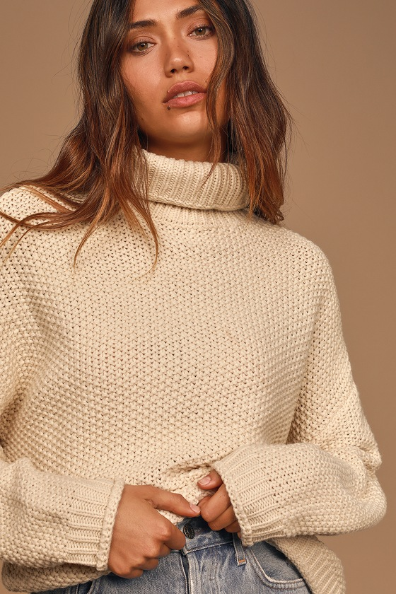 Cozy is calling and the Sage the Label Feel It All Around Beige Knit Turtleneck Sweater is here to answer! Comfy chunky knit shapes this essential sweater that has a turtleneck, long sleeves with drop shoulders, and a boxy bodice. Pair this sweater with your favorite worn-in denim and and ankle boots for a timeless look! Length: Size small measures 23\