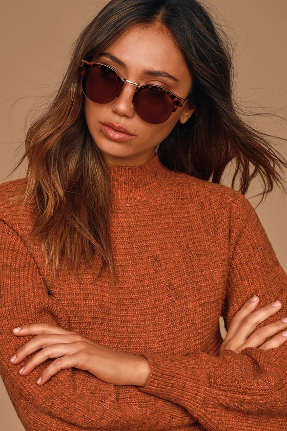 Drive down the coastline in the Lulus Ocean Drive Tortoise Round Sunglasses! These retro-chic sunnies feature a classic round style with tortoise half-frames, gold accent along the nose bridge and top of the frame, and brown tinted lenses. Frames measure 5. 75\