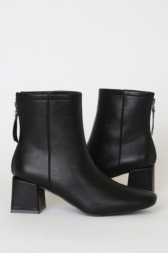 Lulus Exclusive! Step up your shoe game with the Lulus Keaton Black Ankle Booties! These cold-weather essential boots are made from vegan leather and feature an squared-toe upper and ankle-grazing shaft, all atop a trendy squared block heel. 5\